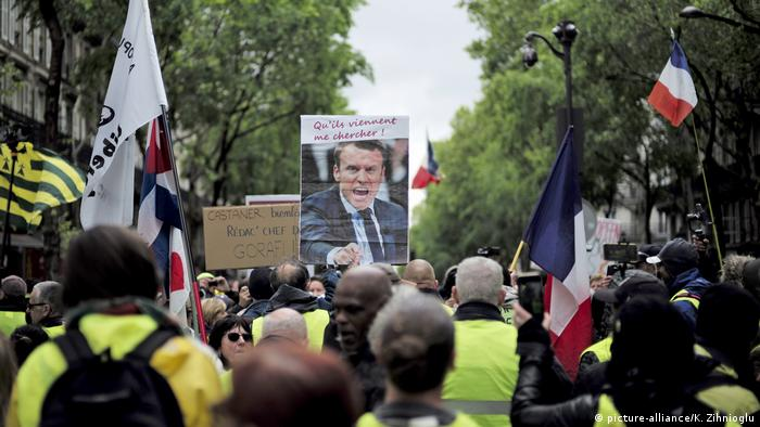 Yellow vest protesters with an image of President Emmanuel Macron 'Let them come and get me.