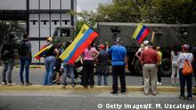 CARACAS, VENEZUELA - MAY 04: Supporters of opposition leader Juan Guaidó wave a Venezuelan flags during a demonstration answering to Guaidó's call for peaceful demonstrations to continue at Generalissimo Francisco de Miranda Air Base on May 4, 2019 in Caracas, Venezuela. Venezuelan opposition leader Juan Guaidó, recognized by many more than 50 nations as the country's rightful interim ruler, called his supporters to convince armed forces to back him up. After the failed attempt to oust Nicolás Maduro on Tuesday, Guaidó insisted that all the armed forces protest together and called on public sector employees to strike. (Photo by Eva Marie Uzcategui/Getty Images)