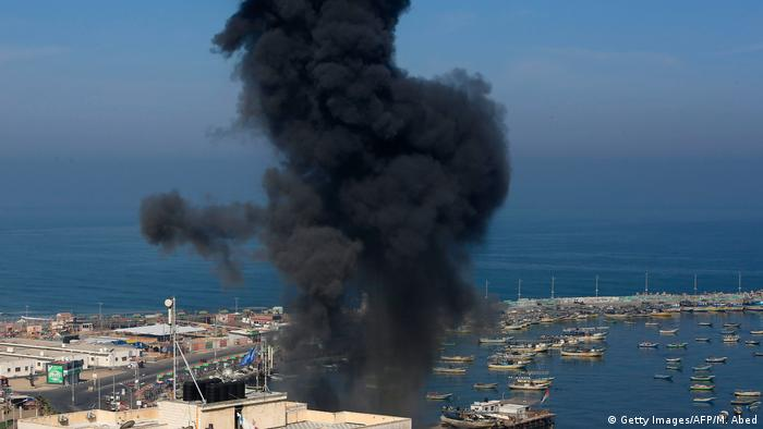Smoke from an air strike near Gaza City's main port