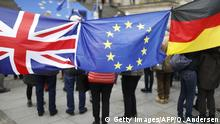 protesters pose with flags of Great-Britain, Germany and Europe during a rally organised by the Pulse of Europe pro-European movement on May 5, 2019 at Gendarmenmarkt square in Berlin. (Photo by Odd ANDERSEN / AFP) (Photo credit should read ODD ANDERSEN/AFP/Getty Images)