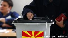 A woman casts her ballot for the presidential election in Skopje, North Macedonia May 5, 2019. REUTERS/Ognen Teofilovski
