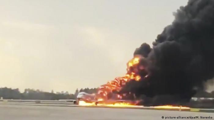 Burning Sukhoi Superjet 100 after a crash landing in Moscow
