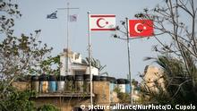 On 25 April 2019, the Greek and Cypriot Republic flags are visible across the separating green line from the Turkish and Turkish Cypriot flags in Nicosia, or Lefkosa, the capital city of Cyprus, which has been divided by a United Nations buffer zone since conflict broke out in 1974 between Greek Cypriots and Turkish Cypriots. (Photo by Diego Cupolo/NurPhoto) | Keine Weitergabe an Wiederverkäufer.