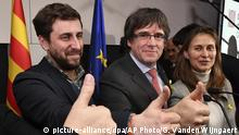 Ousted Catalan leader Carles Puigdemont, center, and former Catalan Health Minister Antoni Comin, left, gesture during a press conference at the Square Meeting Center in Brussels on Thursday, Dec. 21, 2017. The pro-secession bloc won a majority in Catalan regional elections, but the anti-independence Ciutadans (Citizens), led by 36-year-old lawyer Ines Arrimadas, won the highest number of votes for a single party. Several members of the ousted Cabinet, including Puigdemont, have campaigned from Brussels, where they sought refuge from Spanish justice. (AP Photo/Geert Vanden Wijngaert) |