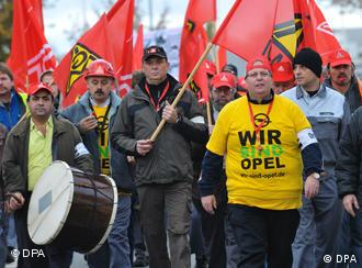 Thousands of Opel workers walk out on the job to protest GM's decision to keep the company