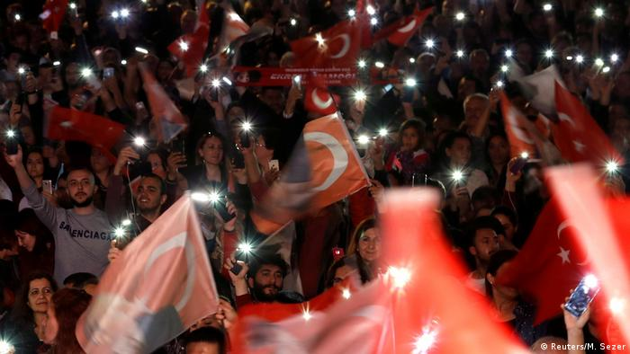 Supporters of the main opposition Republican People's Party (CHP) wave Turkish flags during a gathering to protest after the High Election Board (YSK) decided to re-run the mayoral election, in Istanbul, Turkey, May 6, 2019. (Reuters/M. Sezer)