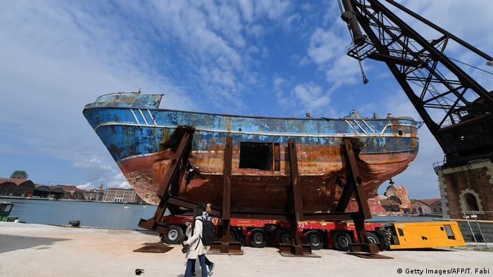 The fishing vessel Barca Nostra (Our Ship) that sank on April 18, 2015 trapping hundreds of migrants in its hull, is being installed in Venice's former shipyards