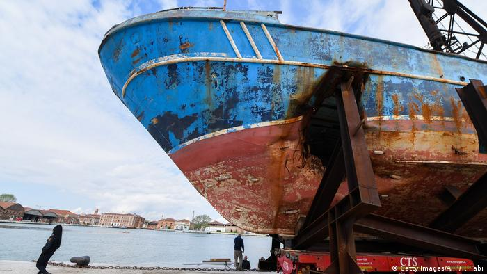 The fishing vessel Barca Nostra (Our Ship) that sank on April 18, 2015 trapping hundreds of migrants in its hull, is being installed in Venice's former shipyard