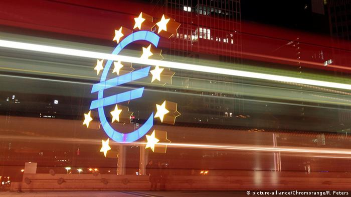 The euro symbol with red lights streaking through it