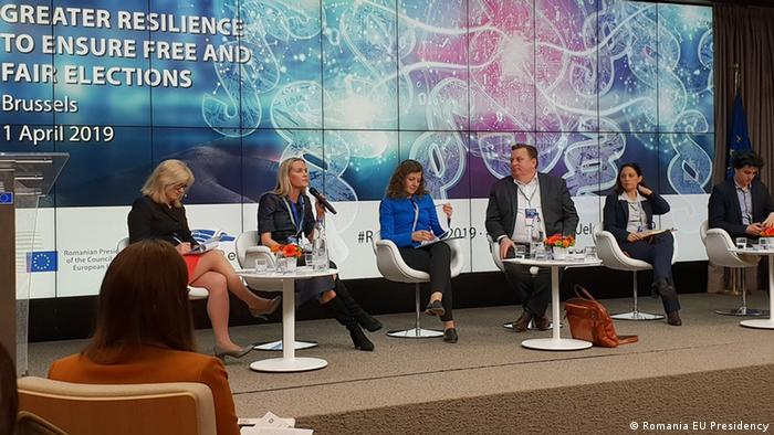 Finnish MEP candidate Aura Salla (with microphone) at a Romanian EU presidency debate on preventing election meddling.