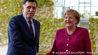 Фаиз Сарадж и Ангела Меркель в Берлине, май 2019 года