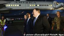U.S. Secretary of State Mike Pompeo, center, walks with Acting Assistant Secretary for Near Eastern Affairs at the State Department David Satterfield, left, and Charge D'affaires at the U.S. Embassy in Baghdad Joey Hood, second from left, and Lt. Gen. Paul LeCamera after arriving in Baghdad, late Tuesday, May 7, 2019. (Mandel Ngan/Pool Photo via AP)  