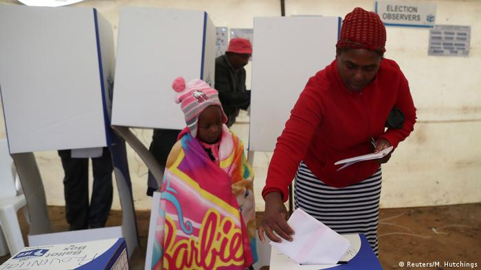 A woman casts her ballot in Johannesburg