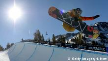 Snowboarderi Gretchen Bleiler performs on the halfpipe