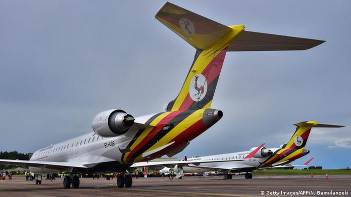 Two bombardier CRJ900 aircraft with the new Uganda Airlines logo on the tail