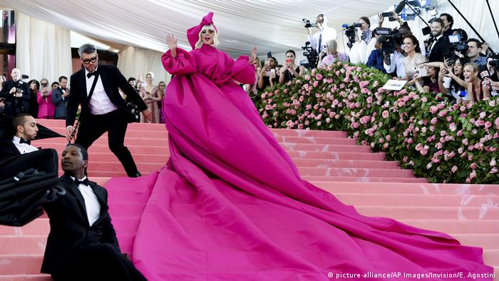 Lady Gaga in an outlandishly long pink dress