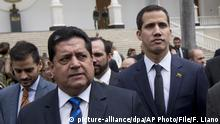 FILE - In this Jan. 5, 2019 file photo, incoming National Assembly Vice President Edgar Zambrano, left, arrives with incoming National Assembly President Juan Guaido, center, and Omar Barboza, outgoing president of Venezuela's National Assembly, to a special session at the Assembly in Caracas, Venezuela. Zambrano was arrested on Wednesday, May 8, 2019, according to Carlos Prosperi, leader of the Democratic Action party, who said Zambrano was in his car when it was surrounded by heavily armed police outside the party's headquarters. His arrest follows a government announcement that Zambrano and several other lawmakers were under investigation for treason and instigating an insurrection. (AP Photo/Fernando Llano, File) |