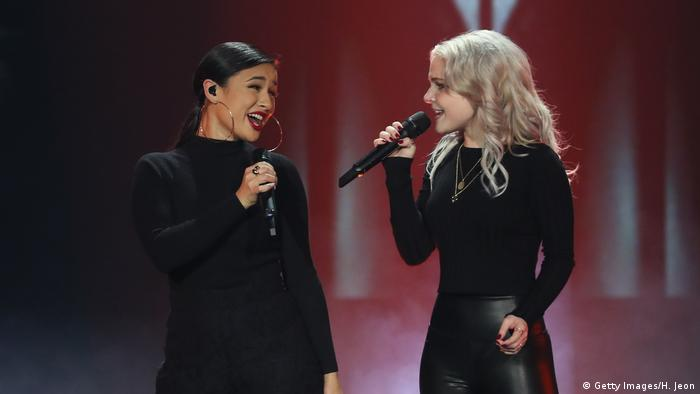 Two singers in black (Getty Images/H. Jeon)