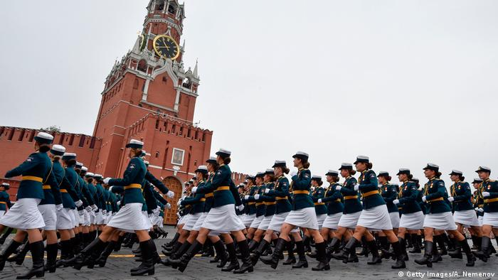 Russian servicewomen march through Red Square during the Victory Day military parade