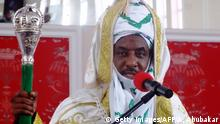 The emir of Kano Muhammadu Sanusi II speaks shortly after receiving staff of office during his coronation as the 57th emir of the ancient Kano emirate on February 7, 2015 at the newly built Coronation Hall near the Kano state governor's office. Sanusi, a former Nigeria central bank chief, was appointed as the emir of the ancient kingdom on June 8, 2014 following the demise of this predecessor Ado Bayero who ruled for 51 years. AFP PHOTO / AMINU ABUBAKAR (Photo credit should read AMINU ABUBAKAR/AFP/Getty Images)