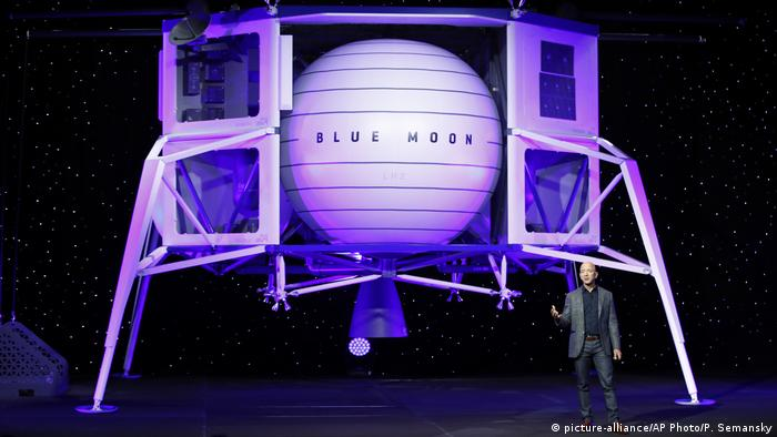 Amazon boss Jeff Bezos presenting a model of a moon lander called Blue Moon which his other company, Blue Origin has built