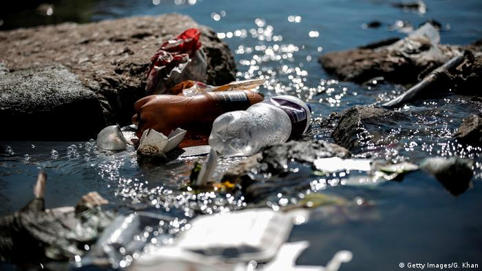 Plastic and other waste litter the banks of the Jukskei River
