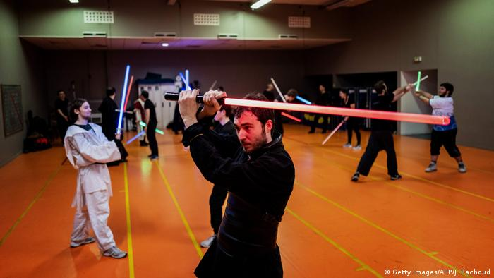 Participants training at the Rapier lightsaber fencing club in Lyon, France (Getty Images/AFP/J. Pachoud)
