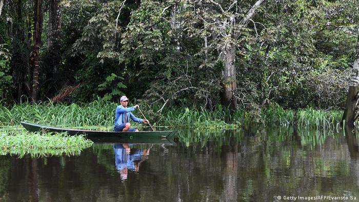 Brazil Amazon rainforest, man on a boat (Getty Images/AFP/Evaristo Sa)
