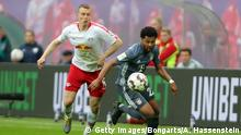 LEIPZIG, GERMANY - MAY 11: Serge Gnabry of Bayern Munich battles for possession with Emil Forsberg of RB Leipzig during the Bundesliga match between RB Leipzig and FC Bayern Muenchen at Red Bull Arena on May 11, 2019 in Leipzig, Germany. (Photo by Alexander Hassenstein/Bongarts/Getty Images)