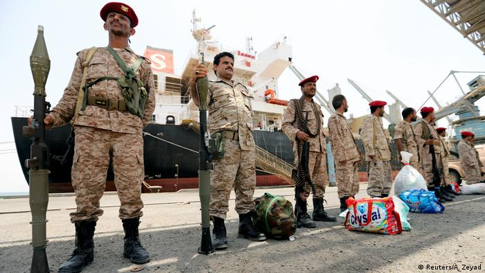 Houthi rebel forces standing in front a boat in Hodeida (Reuters/A. Zeyad)