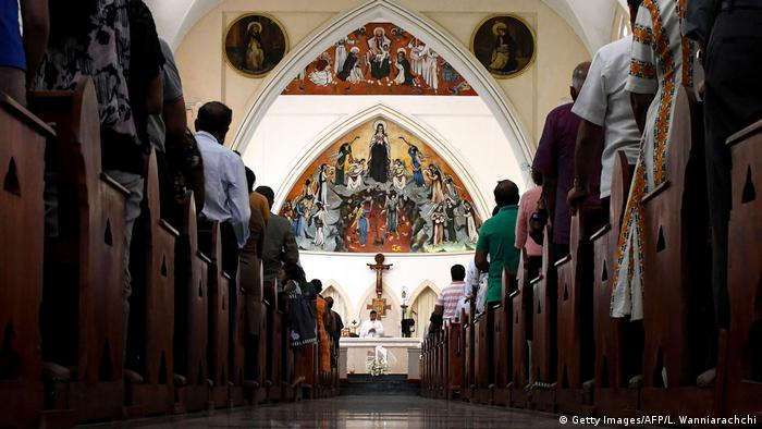 Sri Lankan Catholics pray during a Mass at St. Theresa's Church (Getty Images/AFP/L. Wanniarachchi)
