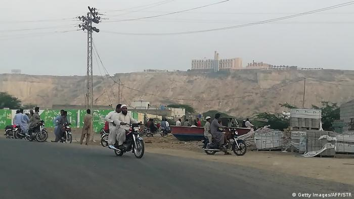 Local residents look at the Pearl Continental from a distance. Gwadar, Pakistan