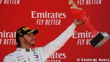 Formula One F1 - Spanish Grand Prix - Circuit de Barcelona-Catalunya, Barcelona, Spain - May 12, 2019 First placed Mercedes' Lewis Hamilton on the podium. REUTERS/Jon Nazca