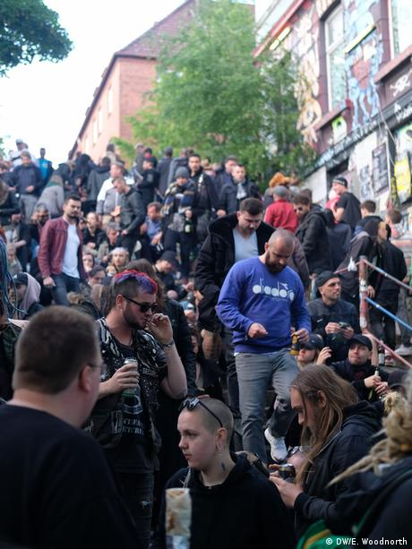 Young people gathered on steps to celebrate in Hamburg's St. Pauli district