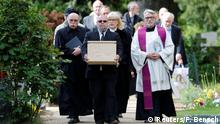 A pallbearer carries a coffin with human tissue of victims executed during the Nazi-era in Germany and used for research at Berlin's Charite university hospital during the Holocaust, at the burial in Dorotheenstadt cemetery in Berlin, Germany May 13, 2019. REUTERS/Fabrizio Bensch