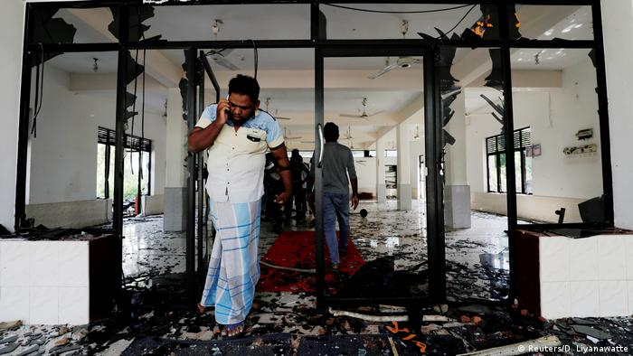 A Muslim man reacts inside the Abbraar Masjid mosque after a mob attack in Kiniyama, Sri Lanka May 13, 2019 (Reuters/D. Liyanawatte)