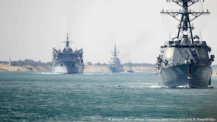 US warships pass through the Suez Canel on the way to the Persian Gulf