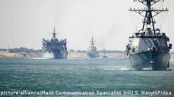 A US aircraft carrier group sails through the Suez Canal