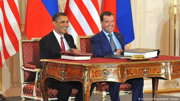 Former US President Barack Obama sitting next to then-Russian President Dmitry Medvedev after signing the New START Treaty