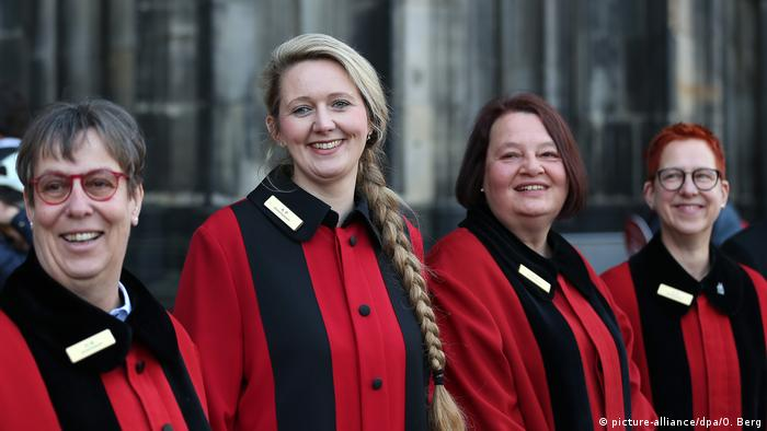 Germany's female stewards in front of the Cologne Cathedral