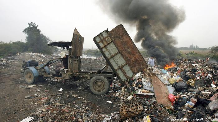 rubbish dump in China, with fire