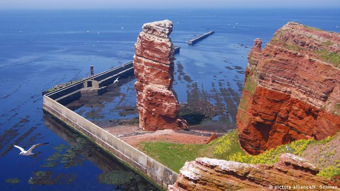 Lange Anna sea stack with protective barrier on the island of Helgoland