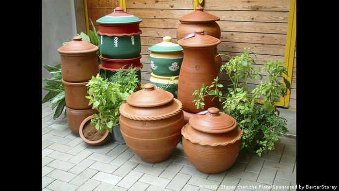 Terra cotta pots with greenery around them (FOOD: Bigger than the Plate/Sponsored by BaxterStorey)