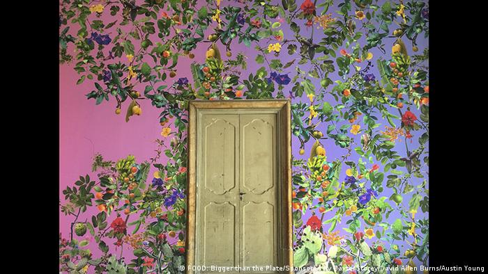 A door in a colorful fruit wallpaper (FOOD: Bigger than the Plate/Sponsored by BaxterStorey/David Allen Burns/Austin Young)
