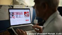 An India man browses through the twitter account of Alt News, a fact-checking website, in New Delhi, India, Tuesday, April 2, 2019. When India's Election Commission announced last month that its code of conduct would have to be followed by social media companies as well as political parties, some analysts scoffed, saying it lacked the capacity and speed required to check the spread of fake news ahead of a multi-phase general election that begins April 11.(AP Photo/Altaf Qadri)