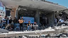 14.05.2019 *** Members of the Palestinian band Dawaween perform during a musical event calling for a boycott of the Eurovision Song Contest hosted by Israel, on the rubble of a building that was recently destroyed by Israeli air strikes, in Gaza City on May 14, 2019. (Photo by MAHMUD HAMS / AFP) (Photo credit should read MAHMUD HAMS/AFP/Getty Images)