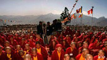 Thousands of Buddhist devotees listen to Tibetan spiritual leader the Dalai Lama during a preaching session in Tawang, in the northeastern Arunachal Pradesh state, India, Monday, Nov. 9, 2009 . Clearly uneasy about the Dalai Lama's weeklong visit to Arunachal Pradesh state, at the heart of a border dispute with neighboring China, Indian officials on Monday clamped down on journalists covering the Dalai Lama's visit. (AP Photo/Manish Swarup)
