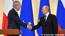 15.05.20149 *** Russian President Vladimir Putin and his Austrian counterpart Alexander Van der Bellen shake hands at the end of a joint news conference following their talks in Sochi, Russia May 15, 2019. Alexander Nemenov/Pool via REUTERS