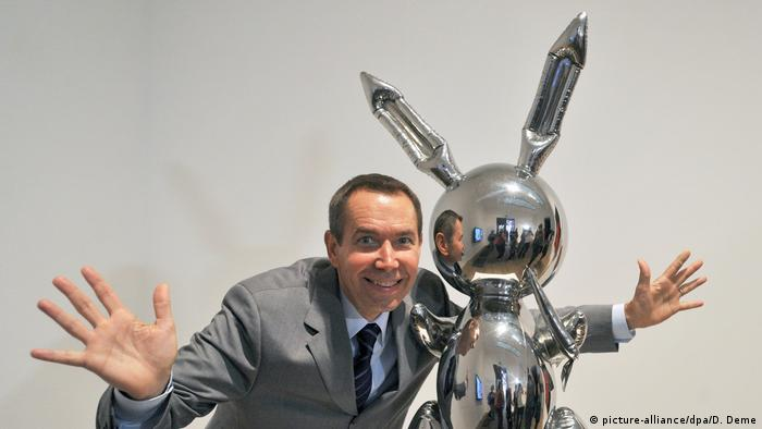Jeff Koons and silver sculpture of a rabbit