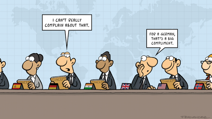 Fernandez cartoon: an international assembly with a German commenting on a concept